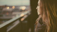 Woman unsure staring out train window