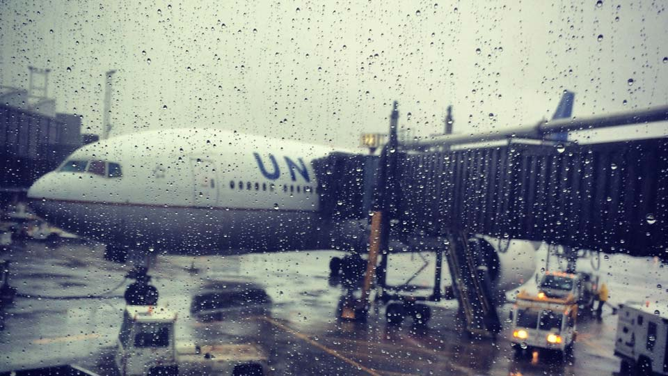 Looking though window at plane , heavy rain